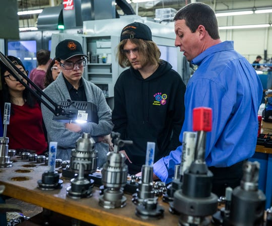 Johnny Freeze, far right, conducts a tour of Peterson Tool Company for students from Desert View High School who were in town for a conference on Feb. 10, 2020.