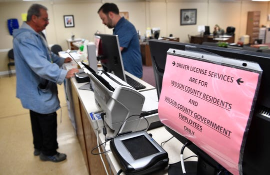 Eddie Ford talks with Deputy Clerk Scott Goodall about applying for the REAL ID on Monday, Feb. 10, 2020, at the Wilson County clerk's office. The office stopped accepting out-of-county residents late last year.
