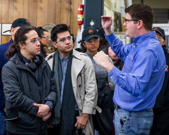 Joe Raker, right, conducts a tour of Peterson Tool Company for students from Desert View High School who were in town for a conference on Feb. 10, 2020.