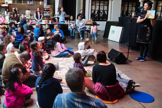 Diane Janbakhsh reads to the children during Bilingual Story Time and Song at Plaza Mariachi Saturday, Feb. 8, 2020, in Nashville, Tenn.