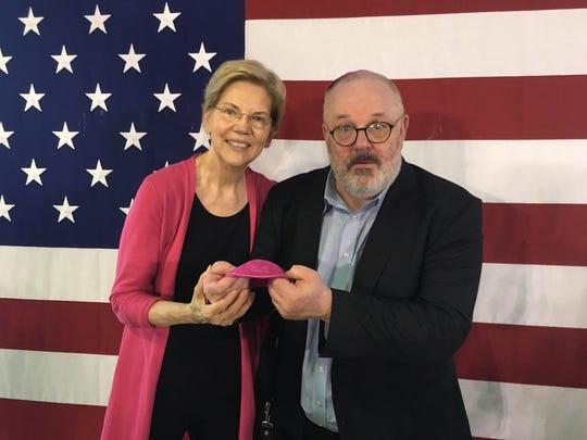 Marc Daniels giving Elizabeth Warren a Warren kippah