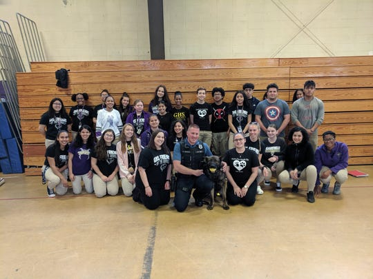 Garfield High School Friends of the Animals club members with Maywood K9 Ryker and Detective Chris Nichols.