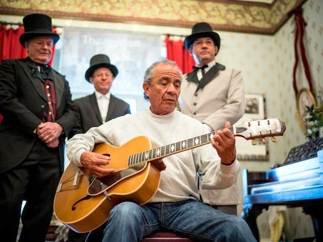 At Territorial Charter Day 2018, Danny Cordova played while charter re-enactors Raul Turrietta, Mike Morones, and Mayor Ken Ladner look on at the Silver City Museum.