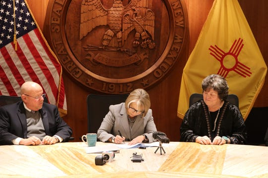 Gov. Michelle Lujan Grisham signs a bill, Monday, Feb. 10, 2020, authorizing $8 million for census outreach.