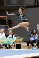 Farmington gymnast Allie Schultz helped lead her team to first place at the Jeanne Caruss Invitational.