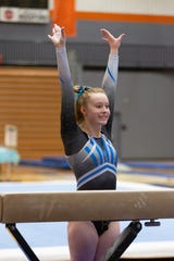 Farmington gymnast Zoe Rasico poses after finishing an event.