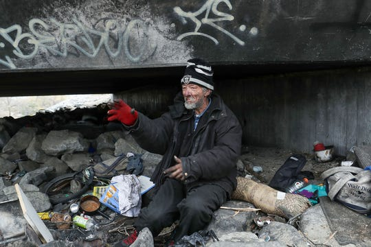 Don Beatty, who is homeless, talks about how he accesses medical care while living under a bridge along the Santa Ana River in San Bernardino, February 9, 2020.