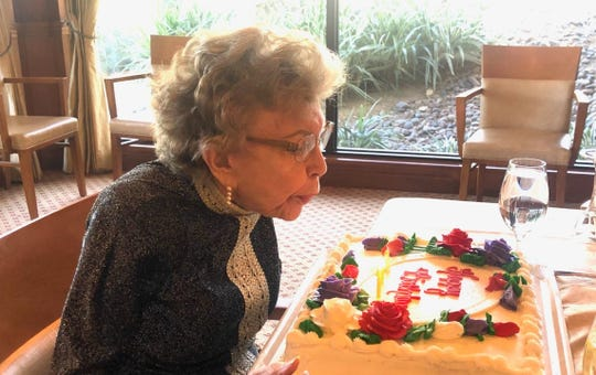 Betty Francis blows out the candles on her birthday cake at Morningside Country Club on Saturday, Feb. 8, 2020.