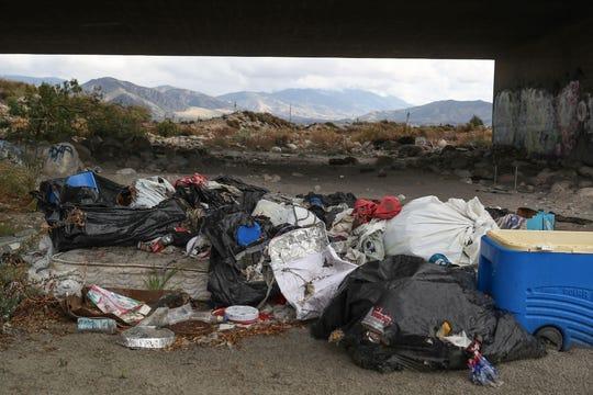 Trash and graffiti litter the landscape under the Orange St. bridge in the Santa Ana River in Redlands, February 9, 2020.