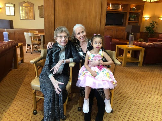 Three generations: Betty Francis shares a moment with former daughter-in-law Cindy Chapman and great granddaughter Hayden.