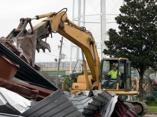 Maverick McCoy of Emerald Coast Demolition tears down the old Seville Diner/Pot Roast and Pinot building on Cervantes Street on Monday, Feb. 10, 2020.
