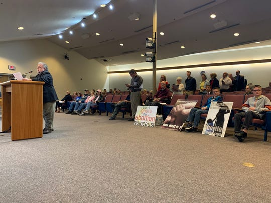 """Anti-abortion advocates crowd the Santa Rosa County Commission board chambers on Monday to encourage the board to put a """"pro-life sanctuary"""" resolution on the agenda."""