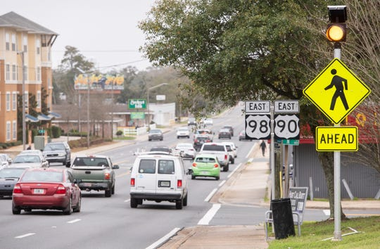 Traffic continues along West Cervantes Street near the corner of N Street in Pensacola on Monday.