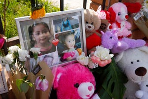 A memorial of photos, flowers and stuffed animals on Feb. 9, 2020, grows outside a home where skeletal remains of a girl were found in Phoenix. The remains of Ana Loera, aka Charisma Marquez, were discovered wrapped in a bedsheet in the attic after a fire in January 2020.
