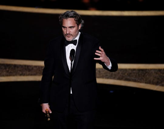 Joaquin Phoenix accepts his Oscar for Performance by an Actor in a Leading Role for 'Joker' during the 92nd annual Academy Awards ceremony at the Dolby Theatre in Hollywood, California, USA, 09 February 2020.