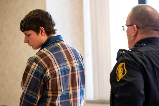 Gerald Glass stands at the podium in St. Clair County Circuit Judge Michael West's courtroom during a sentencing hearing Monday, Feb. 10, 2020, in the St. Clair County Courthouse. Glass pleaded guilty to breaking and entering a building with intent and conspiracy to breaking and entering a building with intent, unlawfully driving a motor vehicle away, malicious destruction of property between $1,000 and $20,000 and fourth-degree arson for breaking into and vandalizing Michigan Corvette and Classic AutoMaxx on Thanksgiving.