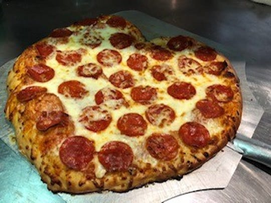 "CJ's Bar and Grill in Port Huron Township will serve heart-shaped pizzas this Valentine's Day and will host a ""Stupid Cupid"" party from 9 p.m. to close."