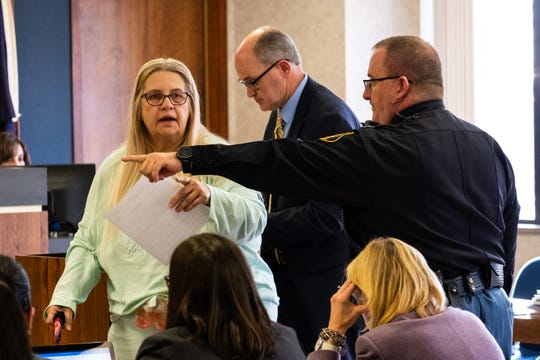 Deborah White, left, is led out of St. Clair County Circuit Judge Michael West's courtroom after her sentencing hearing Monday, Feb. 10, 2020, in the St. Clair County Courthouse in Port Huron. White pleaded guilty to breaking and entering a building with intent and conspiracy to breaking and entering a building with intent for breaking into Michigan Corvette and Classic AutoMaxx on Thanksgiving.