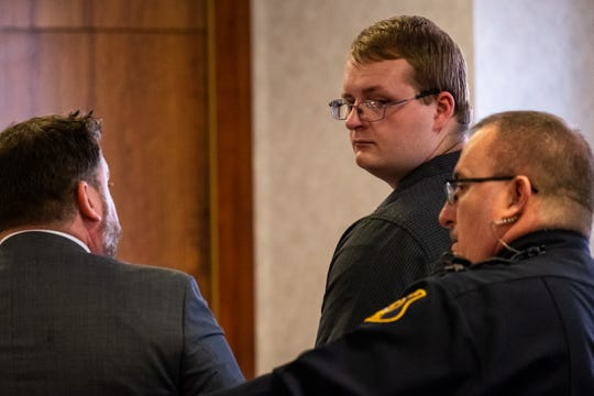 Morgan Morris, center, is guided out of St. Clair County Circuit Judge Michael West's courtroom after his sentencing Monday, Feb. 10, 2020, in the St. Clair County Courthouse in Port Huron. Morris pleaded guilty to breaking and entering a building with intent and conspiracy to breaking and entering a building with intent, unlawfully driving a motor vehicle away, malicious destruction of property between $1,000 and $20,000 and fourth-degree arson for breaking into and vandalizing Michigan Corvette and Classic AutoMaxx on Thanksgiving.