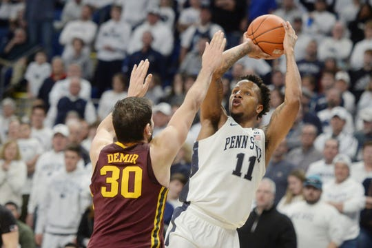 Penn State's Lamar Stevens (11) scores on Minnesota's Alihan Demir (30) in late second-half action of an NCAA college basketball game, Saturday, Feb. 8, 2020, in State College, Pa. (AP Photo/Gary M. Baranec)