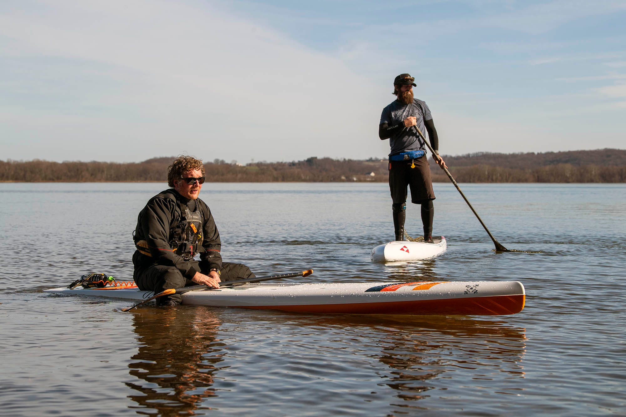 Devin Winand, left, sits on his board next to Josh Hill as they prepare to head back south along the Susquehanna River at Long Level in York County.