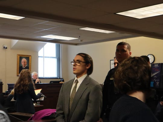 Brandon Clark, dressed in a gray suit rather than his usual orange jumpsuit, leaves the courtroom Monday, Feb. 10, 2020, in Oneida County Court after pleading guilty to the murder of Bianca Devins.