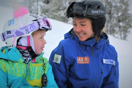 Mackenzie Hunniecutt, left, gets one-on-one snowboard lessons from OAS instructor Dayna Vogt.