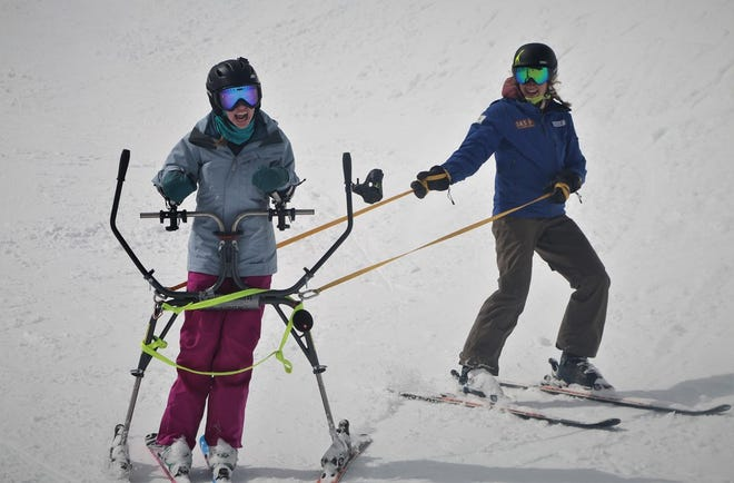 "Using a ""slider"" helps Dana Sherry carve her own turns as she and her instructor Kellie Standish ski the half-pipe at Mt Bachelor."