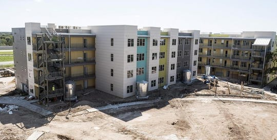 A poll released Thursday says a majority of Texans favor greater government involvement in creating affordable housing.  The Lakeline Station project in Austin was under construction in 2016. It created 128 affordable housing units and a learning center.