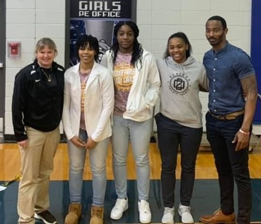 Red River coach Jamie Antilley with BPCC signees Danielle Burton, Ma'Kaila Lewis and Morgyn Payne, and assistant coach Dadrian Harris .