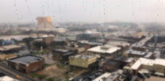Rain drops on a window, overlooking Shreveport-Bossier.