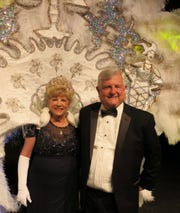 """Queen Justinian XXVI Helen Herzog - dubbed """"Queen Bee"""" of Gotham City - with  hubby John Herzog, takes a bow at the ball."""