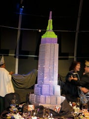 Empire State Building all lit up for Mardi Gras was among centerpieces at tables at Mardi Gras Gala.