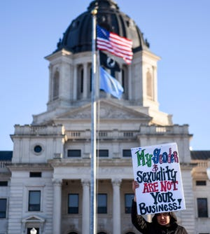 Supporters of transgender rights protest House Bill 1057 on Monday, Feb. 10, 2020 at the Capitol in Pierre, S.D.