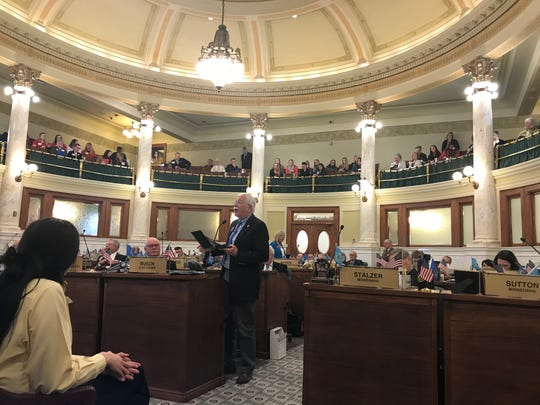 Sen. Arthur Rusch, R-Vermillion, reads the minutes of the South Dakota constitutional convention's decision to print the state Constitution in multiple languages for residents at the time of statehood.