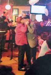 Bob and Bettie Rosendahl celebrate Bettie's 90th birthday at Ebbets Field on East Walnut Street in 2014.
