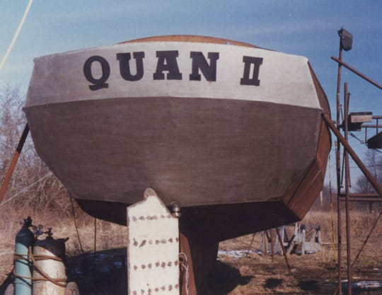 "The boat is named Quan II. A ""quan"" is also known as a ""ditty bag,"" which is a receptacle for odds and ends often used by soldiers or sailors."