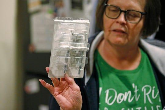 In this Jan. 31, 2020, photo, Ann Lovell holds her prescriptions at her home in South Jordan, Utah.