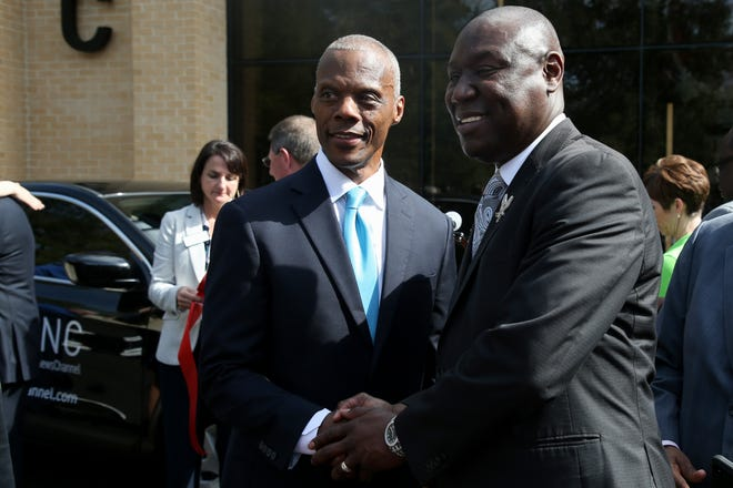 Black News Channel Co-founder J.C. Watts and attorney Ben Crump pose for a photo at the opening celebration of the network Monday, Feb. 10, 2020.