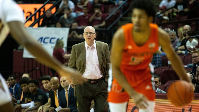 Miami coach Jim Larranaga watches from the sidelines during a game against Florida State last season. Larranaga has lost a friend and a former player to COVID-19.