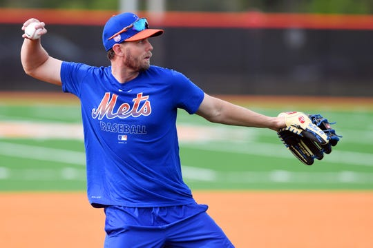 New York Mets' Jeff McNeil works out at third base on Monday, Feb. 10, 2020, on the first day for pitchers and catchers to report to spring training at Clover Park in Port St. Lucie.
