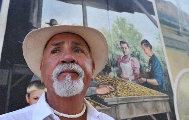 Xavier Montes pauses at a mural in downtown Santa Paula in 2015.