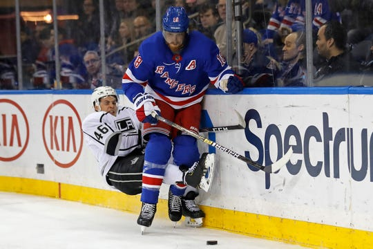 New York Rangers defenseman Marc Staal (18) battles for the puck with Los Angeles Kings center Blake Lizotte (46) in the first period of an NHL hockey game Sunday, Feb. 9, 2020, in New York. (AP Photo/Adam Hunger)