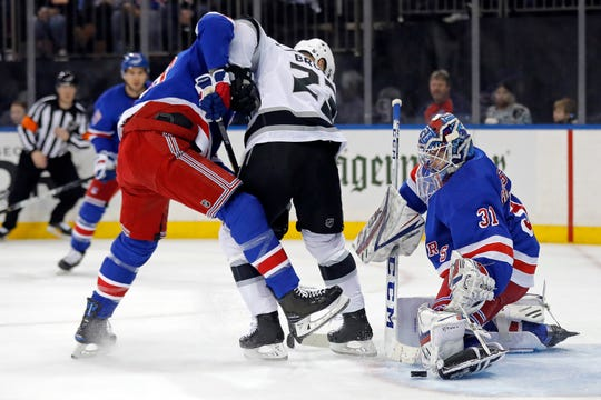 New York Rangers goaltender Igor Shesterkin (31) makes a save in front of Los Angeles Kings right wing Dustin Brown (23) in the first period of an NHL hockey game Sunday, Feb. 9, 2020, in New York. (AP Photo/Adam Hunger)