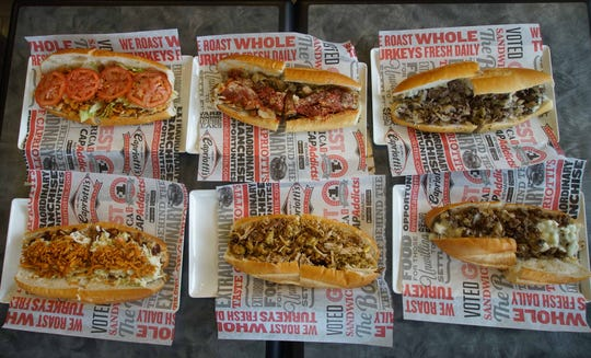 View of the new subs that will be served at Capriotti's in Newark Shopping Center(bottom left to right)BBQ Chicken, Grilled hot Bobbie, Impossible cheesesteak.  (top left to right)Chicken chipotle crunch, Grilled chicken parm, and Classic cheesesteak.