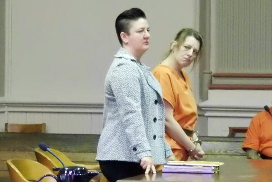 Angela Flores, represented by Nicole Churchill, listens as Assistant Prosecutor John Litle explains the details of her conviction.