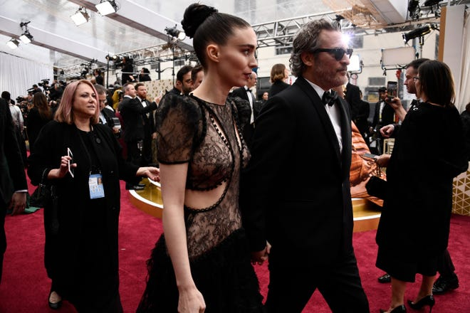 Rooney Mara and Joaquin Phoenix arrive hand in hand.