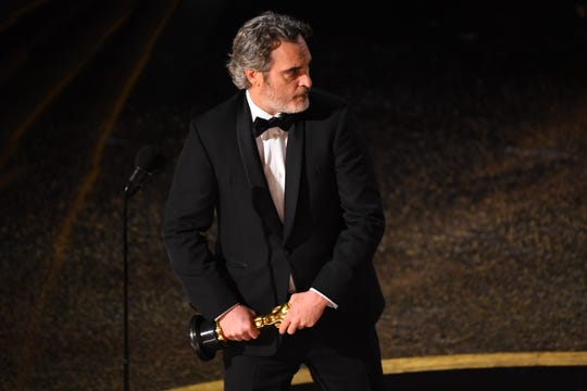 "Joaquin Phoenix accepts his first Oscar, best actor for his role in ""Joker."""