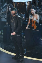 """Eminem performs """"Lose Yourself"""" during the 92nd Academy Awards at Dolby Theatre."""