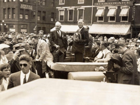 Democratic presidential candidate Franklin D. Roosevelt campaigns in Portsmouth's Market Square in July 1932. Standing next to him is the city's mayor, Fernando W. Hartford, who founded the Portsmouth Herald. The crowd was estimated at 50,000.